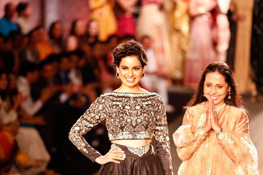 ndian actor Kangana Ranaut displays a dress created by Indian designer Anju Modi at the India Couture Week, held by Fashion Design Council of India, in New Delhi, India,  (AP Photo/Saurabh Das)