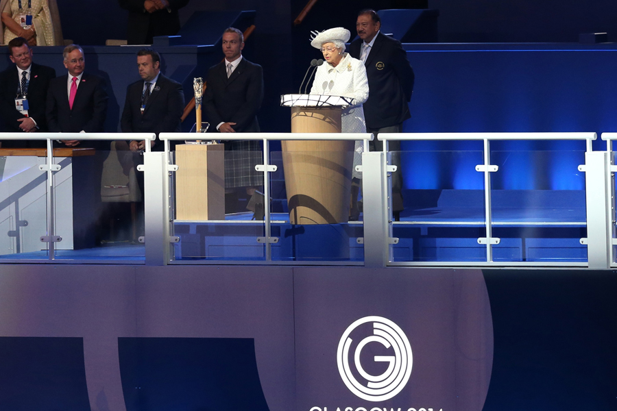 Britain's Queen Elizabeth II reads the message from the Queen's baton during the opening ceremony for the Commonwealth Games 2014 in Glasgow, Scotland