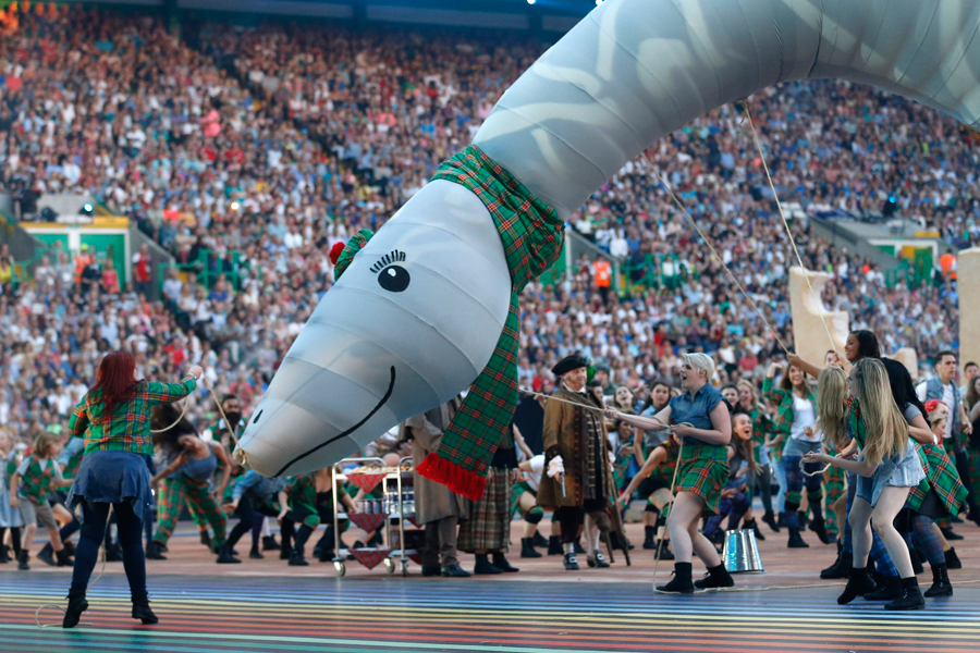 Performers dance with an effigy of the Loch Ness Monster during the opening ceremony for the Commonwealth Games 2014 in Glasgow, Scotland