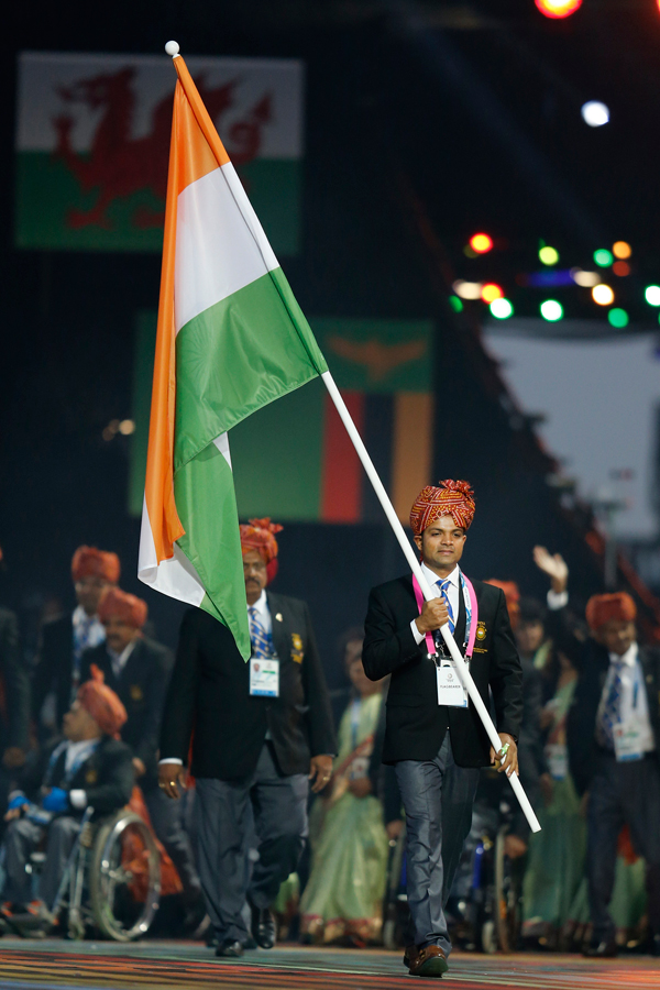 India's flag bearer Vijay Kumar leads his team during the opening ceremony for the Commonwealth Games 2014 in Glasgow, Scotland