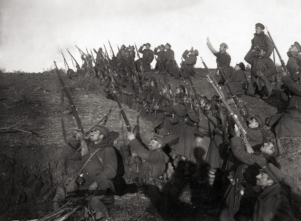 Bulgarian soldiers in a trench, preparing to fire against an incoming airplane. (Wiki)
