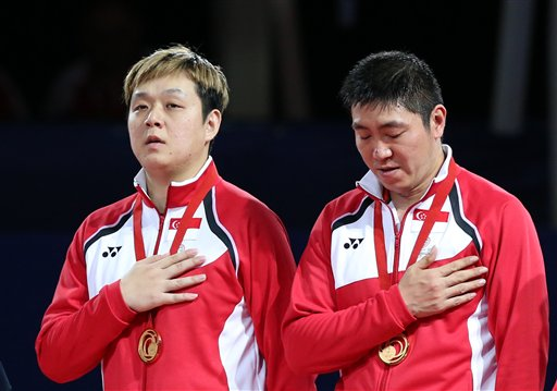 Singapore's Ning Gao,r ight, and Hu Li, gesture, after winning the gold medal in Men's doubles Table tennis final against India's Sharath Kamal Achanta and Amalraj Anthony Arputharaj