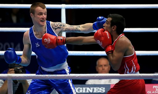 Northern Ireland's Steven Donnelly, left, in action against India's Mandeep Jangra, in the Men's Welter (69kg) Semi-final 2, at the SECC,