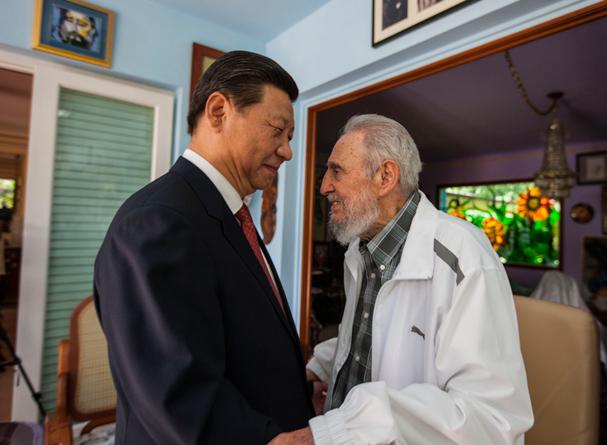 Cuba's Fidel Castro, right, speaks with China's President Xi Jinping in Havana, Cuba