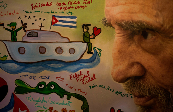 An image of Fidel Castro painted by children with motifs of the revolution and scribbled with happy birthday messages is seen during an exhibition of photographs of Fidel Castro