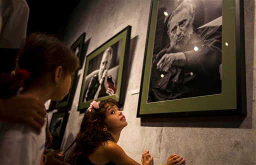 A girl attends an exhibition of photographs of Fidel Castro