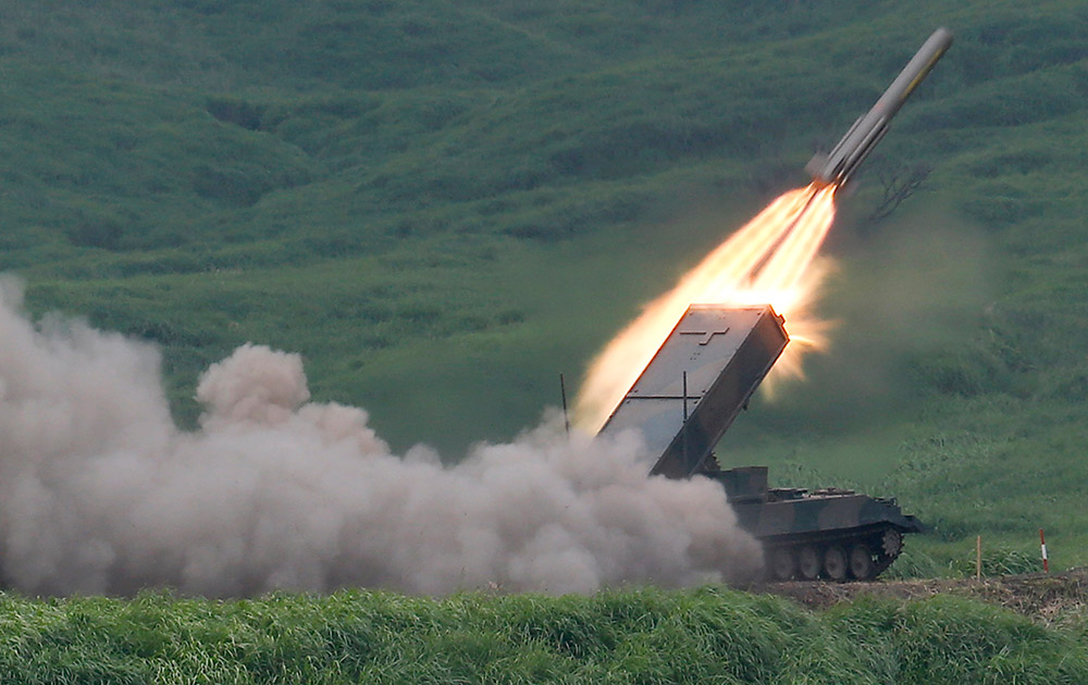 The Japan Ground Self-Defense Force`s anti-landmine missile is launched during an annual live firing exercise at Higashi Fuji range in Gotemba, southwest of Tokyo.