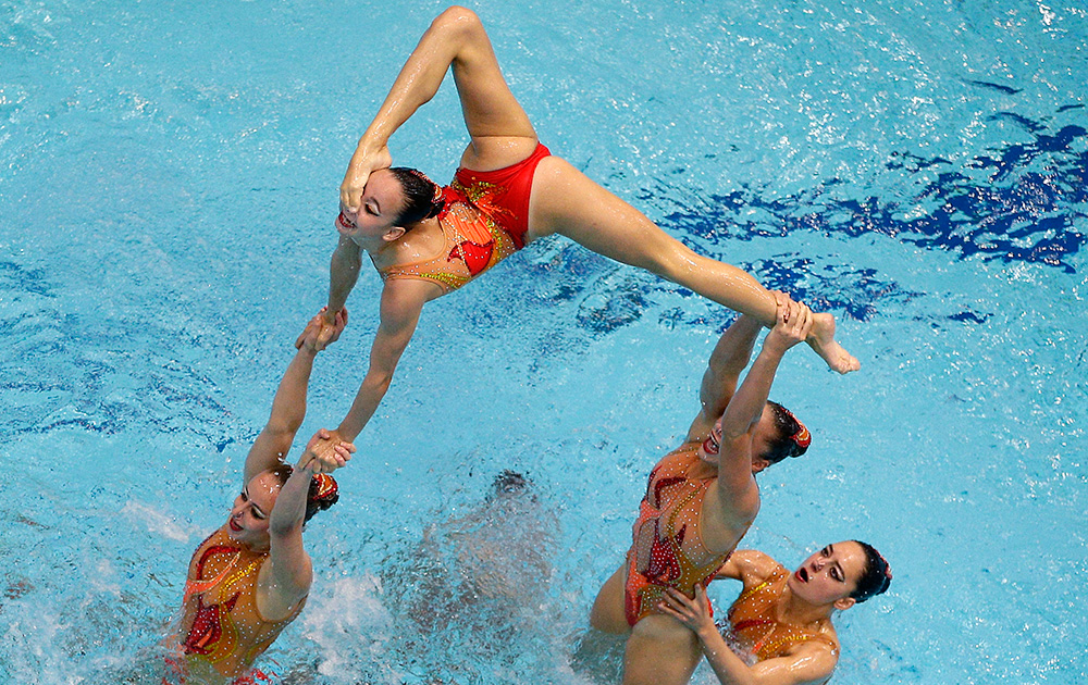 Members of the team from Switzerland perform during the team synchronized swimming free combination preliminary at the LEN Swimming European Championships in Berlin.